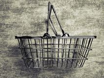 Shopping basket. Metallic shopping basket isolated in background with monochromatic tone Royalty Free Stock Image