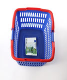 Shopping basket and money Stock Photo