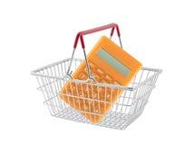 Shopping basket with orange calculator Royalty Free Stock Images