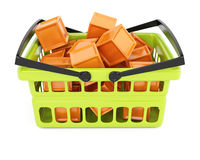 Shopping basket with orange cubes Royalty Free Stock Images