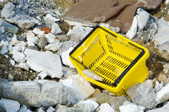 Shopping basket among rubble and rubbish Royalty Free Stock Images