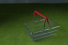 Shopping basket. On a green background Stock Photo