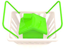 Shopping basket with small house Stock Photo