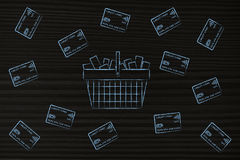 Shopping basket surrounded by credit cards Stock Images