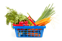 Shopping basket with vegetables. Shopping basket filled with healthy vegetables over white background Stock Photo