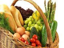 Shopping basket with vegetables, bread and fruits Stock Photography