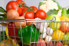 Shopping basket with veggies Royalty Free Stock Images