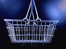 Shopping basket. View of isolated metallic shopping basket with blue tone Royalty Free Stock Photo