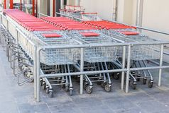 Shopping baskets or carts. Silver shopping baskets or carts with red handle Royalty Free Stock Photos