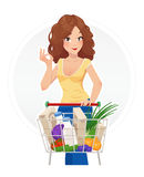 Shopping beautiful girl with cart Royalty Free Stock Photography