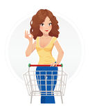 Shopping beautiful girl with cart Stock Image