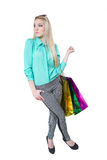 Shopping beautiful happy girl with colored bags Royalty Free Stock Photos