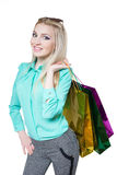 Shopping beautiful happy girl with colored bags Royalty Free Stock Image