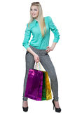 Shopping beautiful happy girl with colored bags Stock Photos