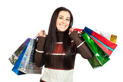 Shopping. Beautiful Happy Girl with Shopping Bags. Stock Photo