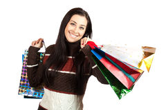 Shopping. Beautiful Happy Girl with Shopping Bags. Royalty Free Stock Photography