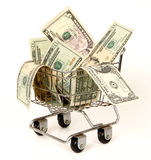 Shopping for the Best Deal. Shopping cart filled with money. Concept of shopping for the best deal before buying Royalty Free Stock Photography