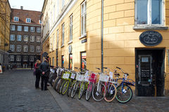 Shopping for a bicycle in Copenhagen Denmark. Customers at a Copenhagen bicycle store checking out the spring arrivals Royalty Free Stock Image