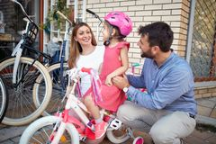 Shopping bicycle - The family buys a new bicycle for a happy girl in a bicycle store. Shopping bicycle - Family buying new bicycle for happy little girl in bike stock photography