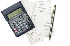 Shopping bills ,pen and calculator Royalty Free Stock Photography