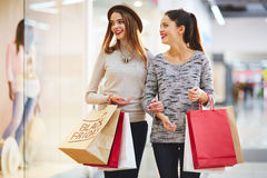 Shopping on Black Friday. Stylish girls visiting Black Friday sale Royalty Free Stock Photography