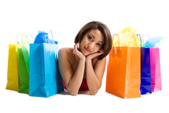 Shopping black woman. An isolated shot of a black woman with shopping bags Royalty Free Stock Photo
