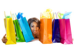 Shopping black woman. An isolated shot of a black woman with shopping bags Royalty Free Stock Photography