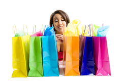 Shopping black woman. An isolated shot of a black woman with shopping bags Royalty Free Stock Photos
