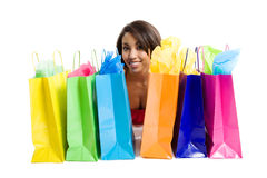 Shopping black woman. An isolated shot of a black woman with shopping bags Stock Photos
