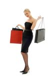 Shopping blond in black dress Royalty Free Stock Image