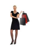 Shopping blond in black dress. Elegant blond with shopping bags over white Royalty Free Stock Photography