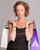 Shopping blond girl Stock Image