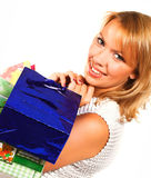 Shopping blond woman over a white background. Shopping sexy woman over a white background Royalty Free Stock Images