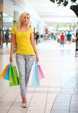 Shopping. Blonde Woman with Colorful Shopping Bags Stock Photography