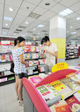 Shopping books. The two women shopping health books,modern Chinese women began to consciously pay attention to their health.Photo taken in August 28, 2011, Wuxi Royalty Free Stock Photography
