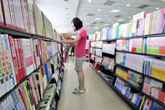 Shopping in a bookshop. A chinese female high school student shopping in a bookshop,photo taken in August 28, 2011, Wuxi Xinhua Bookstore Royalty Free Stock Images