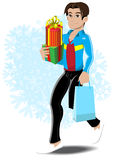 Shopping boy. Boy holding gifts and shopping bag Stock Photo