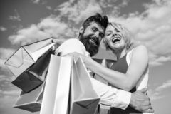 Shopping brings positive emotions. Man beard and blonde girl enjoy buy clothing. Family bought excellent clothes. Happy. Couple satisfied purchases. Couple with stock photos