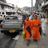 Shopping buddhist monks. Two young buddhist monks in Kandy Sri Lanka Royalty Free Stock Photography