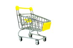 Yellow shopping cart isolated on white background. Selective focus royalty free stock photo