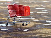 Shopping Cafrt. A shopping cart that has been left in a snowy parking lot Royalty Free Stock Image