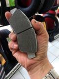Car brake pad in hand close. Shopping car brake pad in hand close Stock Images