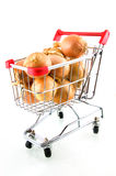 Shopping car with onions. Isolated on white background royalty free stock image