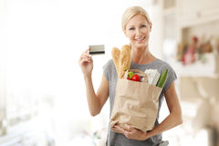 Shopping by card at supermarket Stock Photo