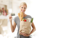 Shopping by card at supermarket Stock Images