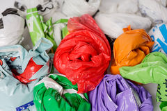 Shopping carrier bags. Plastic shopping carrier bags, rolled up for storage Stock Photos
