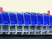 Shopping cars. Blue shopping carts lined up stock image