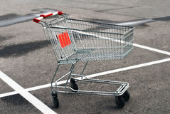 Shopping cart. Empty shopping cart at the supermarket parking lot Stock Photos