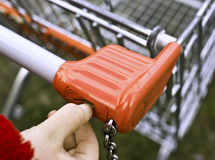 Shopping Cart. Slot and finger introducing coin royalty free stock photo