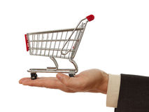 Shopping cart. On palm of business man Stock Photography